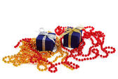 Package with gifts and Christmas ornaments isolated on a white b — Stock Photo