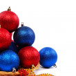 Stock Photo: Christmas balls and decorations isolated on a white background.