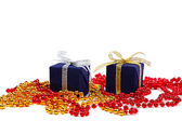 Package with gifts and Christmas ornaments isolated on a white b — 图库照片