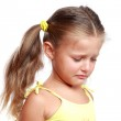 Portrait of a sad sweet little girl isolated on white background — Stock Photo #33481195