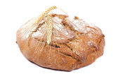 Loaf of rye bread and wheat ears. — Stock Photo