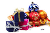 Package with gifts and Christmas ornaments. — Стоковое фото