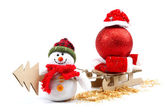 Snowman with sledge, Christmas tree, red ball and Santa Claus ha — Stock Photo