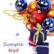 Stock Photo: Package with gifts and Christmas ornaments.