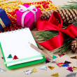 Christmas decorations, gifts and a notebook for congratulations. — Zdjęcie stockowe