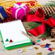 Foto Stock: Christmas decorations, gifts and a notebook for congratulations.