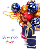 Package with gifts and Christmas ornaments. — Stock Photo