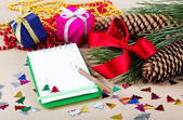 Christmas decorations, gifts and a notebook for congratulations. — Стоковое фото