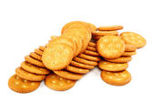 Stack of cracker biscuits on a white background. — Stock Photo