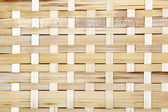 Wooden grid, the background of woven wood. Bamboo wood texture. — ストック写真