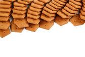 Stapel von cracker kekse auf weißem hintergrund. — Foto Stock