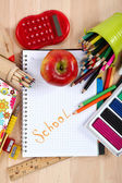 School and office supplies on a wooden table. — Stock Photo