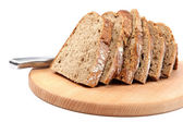 Slices of bread with a knife on a cutting board. — Stock Photo