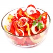 Photo: Fresh vegetable salad in glass dish on white background.