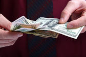 Banknotes in the hands of a businessman. — Photo