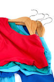 Fashion clothing on hangers at the show on white background. — Stock Photo