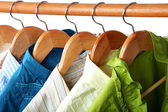 Fashion clothing on hangers at the show. — Stock Photo