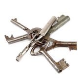 Old keys on a white background. — Stock Photo