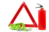 Car kit. Fire extinguisher, emergency sign and tow rope. — Stock Photo