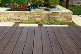 Wood floor over background beautiful modern decorative garden de — Stock Photo