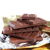 Chocolate bar in foi. — Stock Photo