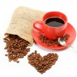 Hearts made from coffee beans around a cup of coffee on a — Stock Photo #9451994