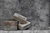 Old pile brick on wooden background (Still life) — Stock Photo
