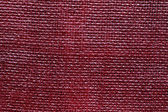 Red linen board texture — Stock Photo