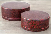 Antique lacquer wares on wooden table — Stock Photo