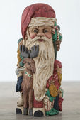 Antique wooden santa on wooden table — Stock Photo