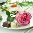 Romantic dinner with rose on a plate — Stock Photo #6779125