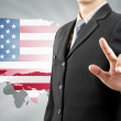 Businessman hand pushing and USA world background — Stock Photo