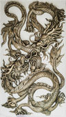 Dragon sculpture on wall — Stock Photo