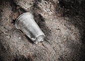 Garbage plastic glass on the beach — Stock Photo