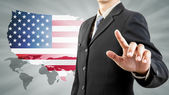 Businessman hand pushing and USA world background — Stock Photo