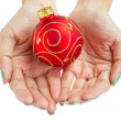 Royalty-Free Stock Photo: Female woman hand holding Christmas ball