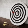 Royalty-Free Stock Photo: Success concept, darts hit target on dartboard