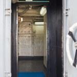Handle of white ship door open inside — Stock Photo #18698567