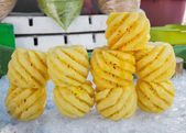 Pile of pineapples slices stack on ice — Stok fotoğraf