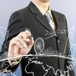 Stock Photo: Businessman hand drawing the dream travel around the world