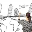 Asiwomdrawing or writing dream travel around world — Stock Photo #22352837