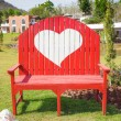 Green grass and heart shape on bench in the garden — Stockfoto