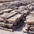 Stack of chock wood for train, construction site - Stok fotoğraf