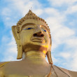 Buddha statue and blue sky - Photo