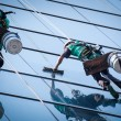 Group of workers cleaning windows service on high rise building — Stockfoto #22353767