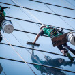 Group of workers cleaning windows service on high rise building - Stok fotoğraf
