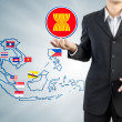ASEAN Economic Community in businessman hand - Photo