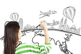 Asian woman drawing or writing dream travel around the world — Stock Photo