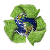 "Recycle logo symbol from the green grass and earth. ""Elements of — Stock Photo"