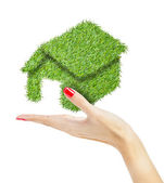 Green house in hand — Stock Photo